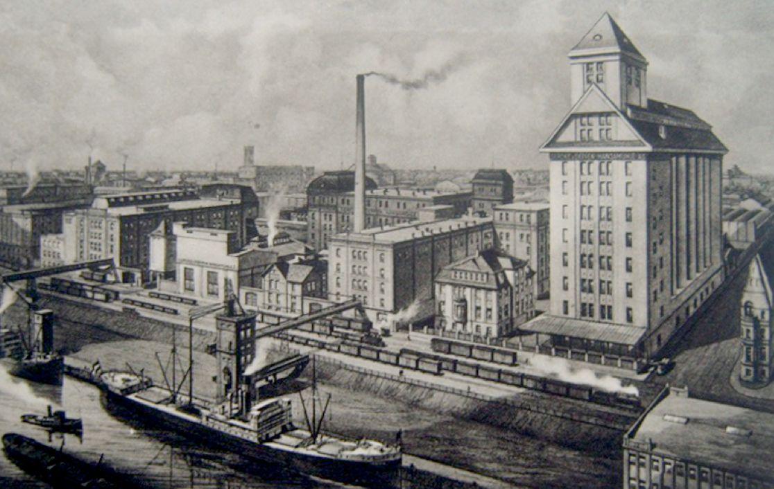 Ein Stück Industriegeschichte am Holzhafen: die Hansamühle (rechts) und die Bremen-Besigheimer Oelfabriken AG (links) nach dem Wiederaufbau um 1910. Quelle: Peter Strotmann